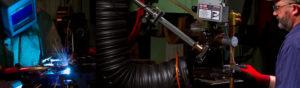 Clow Stamping Employee works using 200 KVA spot welders