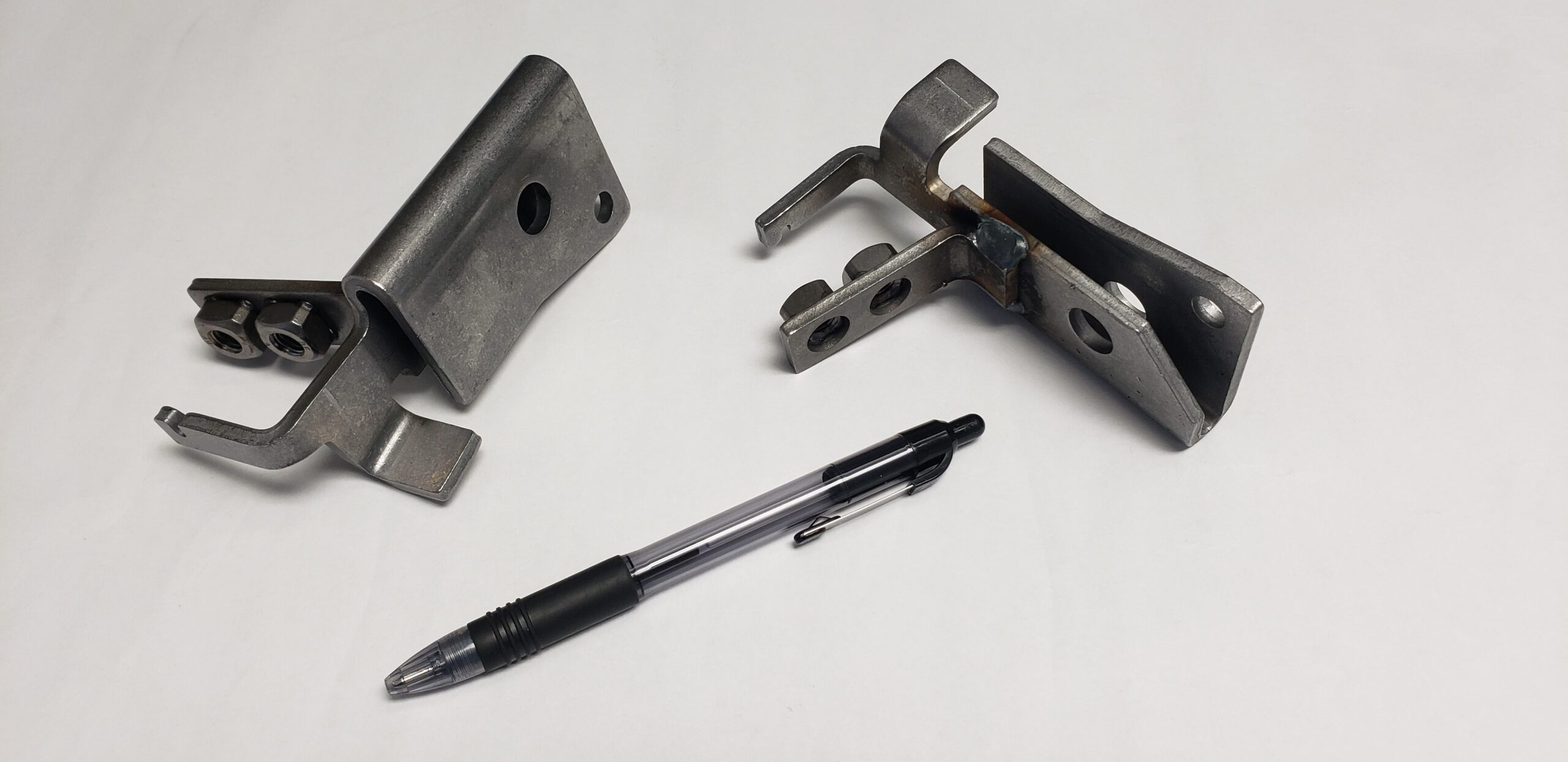 """This 6"""" X 5"""" part is made of .180 thick HRPO (Hot Rolled Pickled Oil) material and Weld Nuts"""